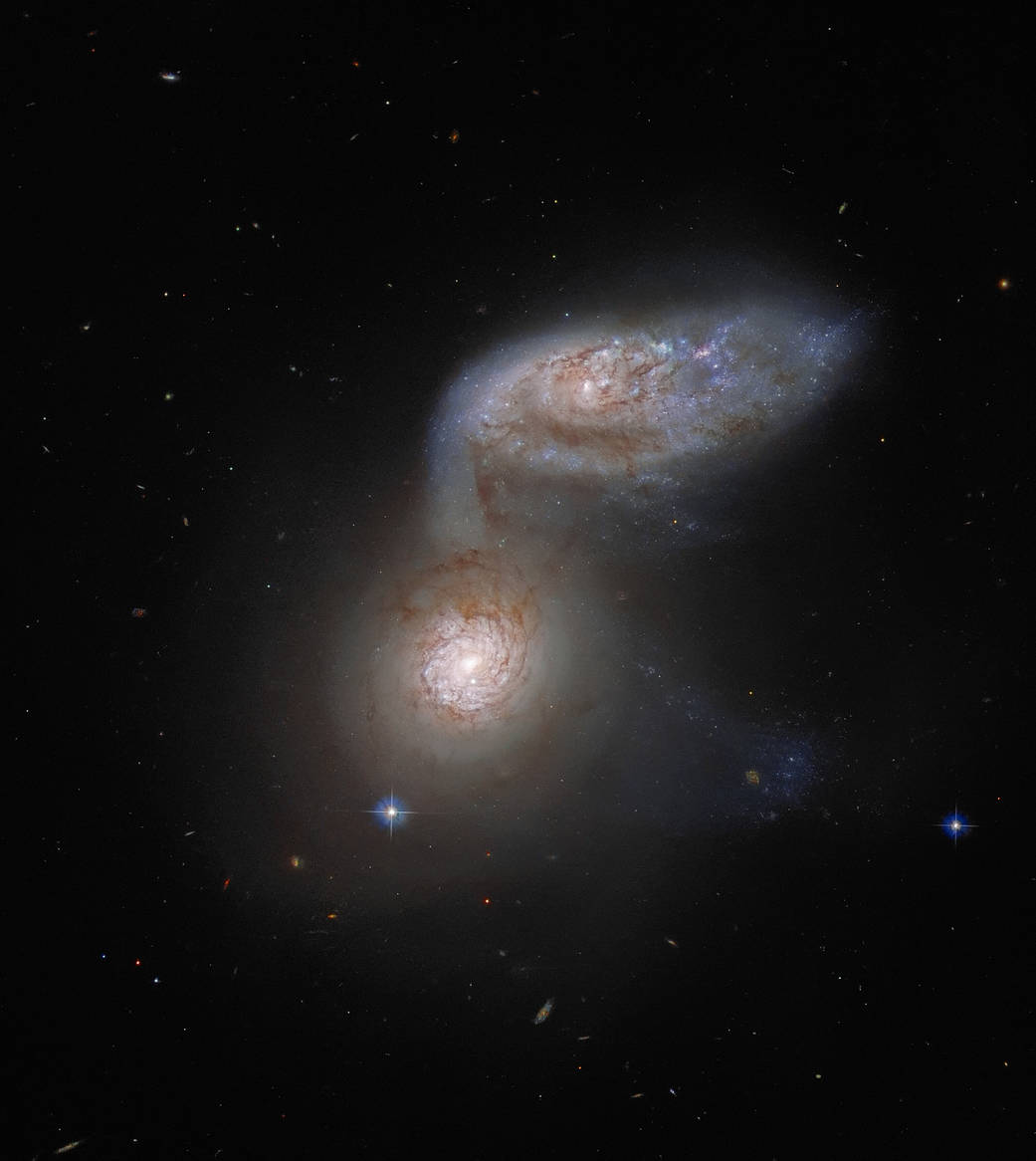 The merging of two galaxies 'ARP 91' is captured by Hubble Telescope!